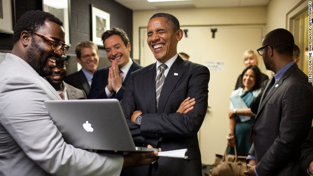 "President Barack Obama lets out a laugh as he is briefed by host Jimmy Fallon and his producers on the ""Slow Jam the News"" segment before his appearance on ""Late Night with Jimmy Fallon"" in April 2012."