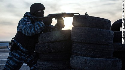 Pro-Russian forces muscle into base