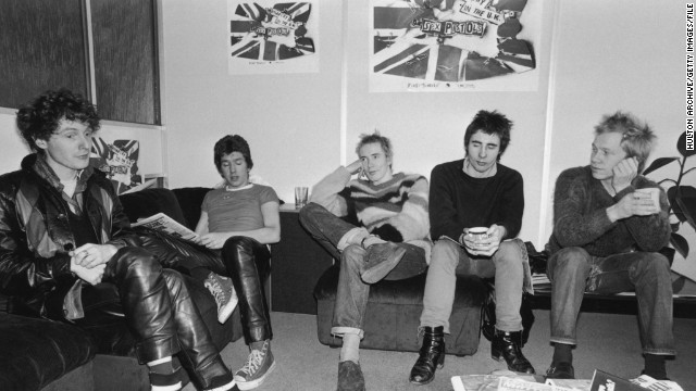 Westwood started her first clothes shop with Sex Pistols manager Malcolm McLaren (far left), pictured here with the British punk band in 1976.
