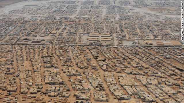 This is an aerial photograph of the Zaatari refugee camp, situated eight kilometers from the Jordan/Syria border, taken on July 18, 2013. As many as 150,000 people are now living there, with more arriving every day.<!-- --> </br>