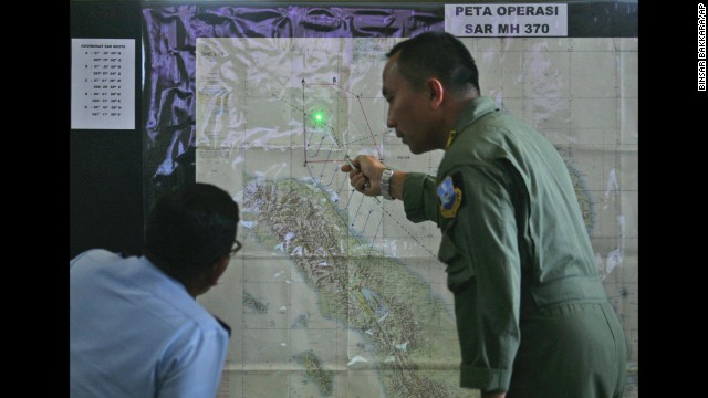 Indonesian air force officers in Medan, Indonesia, examine a map of the Strait of Malacca on March 12.