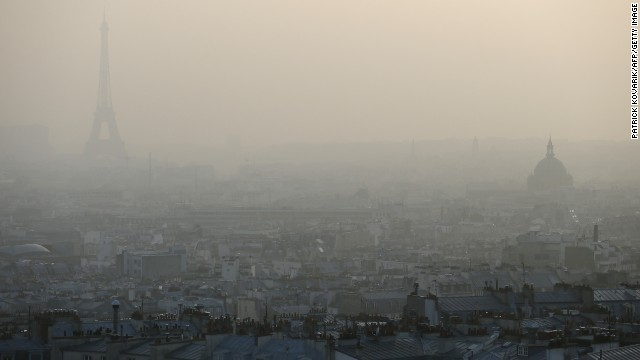 "MARCH 12 - PARIS, FRANCE: The Eiffel tower and the roofs of Paris are only just visible through a haze of pollution. City officials said people prone to health problems, children and seniors should remain indoors as three environmental organizations filed a lawsuit against the city for ""<a href='http://edition.cnn.com/2013/10/17/health/geneva-air-pollution-carcinogenic-who/'>endangering the lives of others</a>"" by their lack of response."