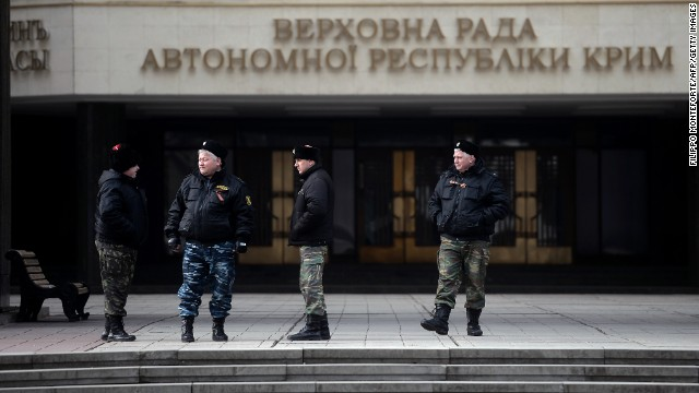 Cossacks stand guard at Crimea's regional parliament building in Simferopol on March 12.