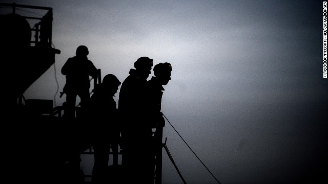 Soldiers patrol aboard the Ukrainian ship Slavutich in the harbor of Sevastopol, Ukraine, on Tuesday, March 11.