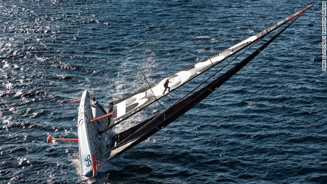 Thomson hurtles up the mast aware that the boat can keel at any moment and fling him onto the deck or the water below.