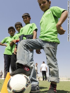 Football's world governing body FIFA donated t-shirts to children at the Zaatari refugee camp last year. The organization Save the Children has also built a football pitch inside the camp.