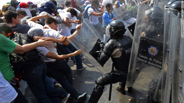 Venezuelan students clash with riot police during a protest against the government of Venezuelan President Nicolas Maduro in Caracas on Wednesday, March 12. For weeks, anti-government protesters in Venezuela, unhappy with the economy and rising crime, have been clashing with security forces.