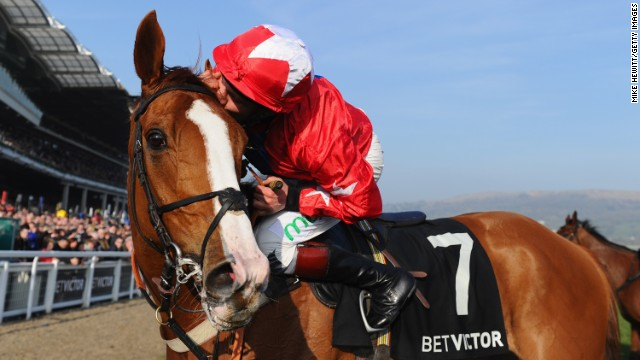 Jamie Moore rode Sire de Grugy to victory in the Queen Mother Champion Chase at Cheltenham.
