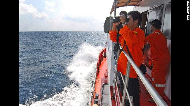 A member of the Indonesian National Search and Rescue Agency scans the horizon in the Strait of Malacca on Wednesday, March 12.