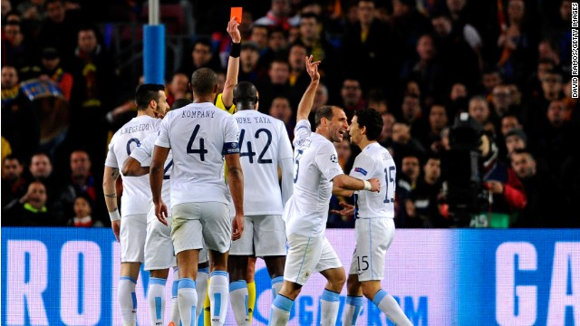 City's Pablo Zabaleta was shown a second yellow card and was then sent off by referee Stephane Lannoy after complaining about the failure to award his side a penalty. Edin Dzeko was sent tumbling by Gerard Pique but the referee waved play on.