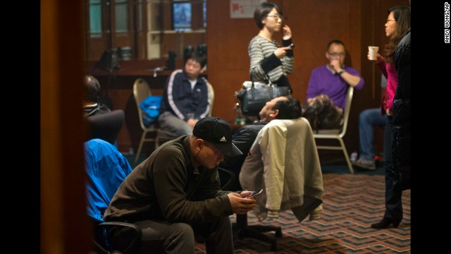 Relatives of missing passengers wait for the latest news at a hotel in Beijing on March 12.