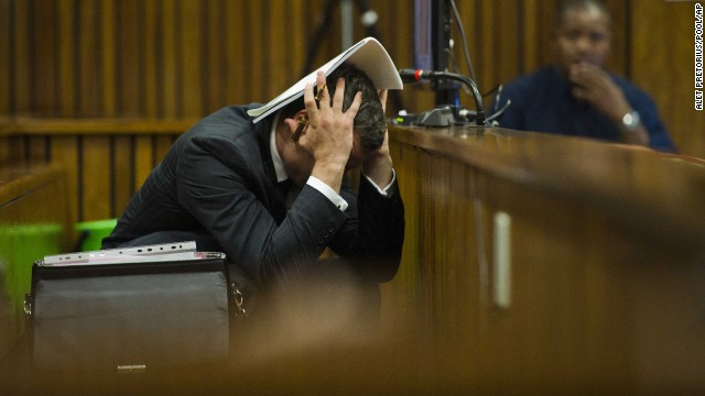 Oscar Pistorius covers his head as he listens to forensic evidence during his trial in Pretoria, South Africa, on Thursday, March 13. Pistorius, the first amputee to compete in the Olympics, is accused of murdering his girlfriend, Reeva Steenkamp, on February 14, 2013.