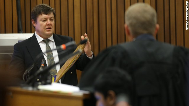 Forensic investigator Johannes Vermeulen, left, is questioned during the trial on March 13.