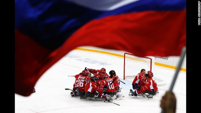 Russia's men's hockey team celebrates after winning a semifinal match against Norway on Thursday, March 13.