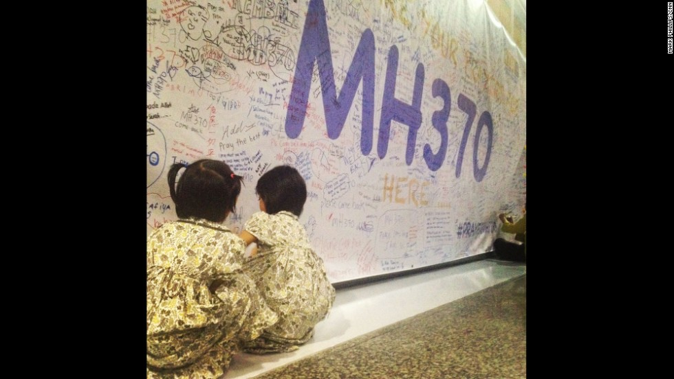 SEPANG, MALAYSIA: Two young girls leave messages and well wishes on the walls of Kuala Lumpur International Airport (March 13) for those on board the missing Malaysia Airlines jetliner MH370. Photo by CNN's Mark Phillips. Yet another conflicting storyline emerged overnight in the perplexing disappearance of Malaysia Airlines Flight 370 nearly six days ago. After search crews failed to find any trace of debris suggested by Chinese satellite photographs, Malaysian officials on Thursday (March 13) denied a newspaper report that suggested the plane may have kept flying for four hours after its last reported contact. <a href='http://www.cnn.com/2014/03/13/world/asia/malaysia-airlines-plane/index.html?hpt=hp_t1'>FULL STORY AT CNN.COM</a> Follow Mark (<a href='http://instagram.com/markpcnn' target='_blank'>@markpcnn</a>) and other CNNers along on Instagram at <a href='http://instagram.com/cnn' target='_blank'>instagram.com/cnn</a>.
