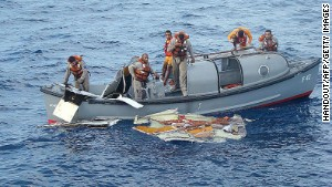 Crew members from the Brazilian frigate Constituicao recover pieces of Air France Flight 447 from the Atlantic in June 2009.