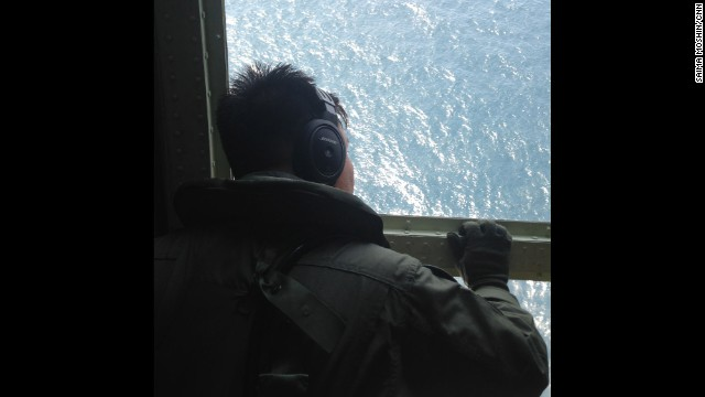 The air crew looks out of a window during a search and rescue operation for the missing Malaysia Airlines plane over the Straits of Malacca. Photo by CNN's Saima Mohsin, March 10. Follow Saima on Instagram at instagram.com/saimamohsincnn.