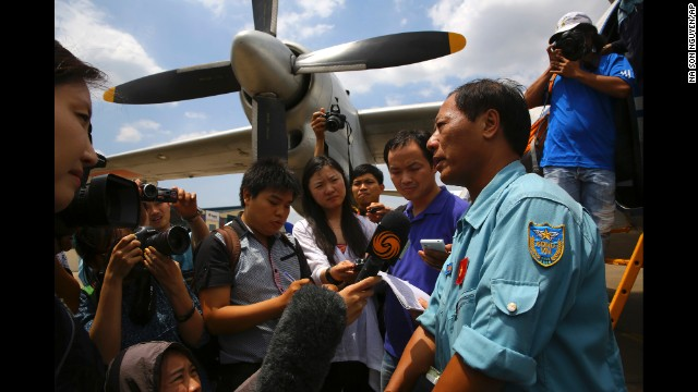 Col. Vu Duc Long of the Vietnam air force fields reporters' questions at an air base in Ho Chi Minh City, Vietnam, after a search operation on Friday, March 14.