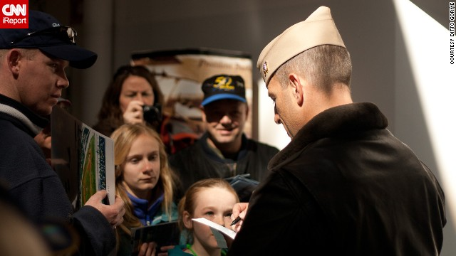After practice flights, pilots go to the Naval Aviation Museum to meet the fans and sign autographs.