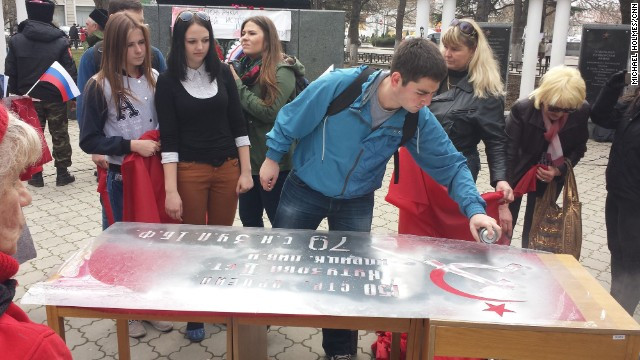 "SIMFEROPOL, UKRAINE: ""Pro-Soviet flags being made and handed out in Simferopol on Marc"