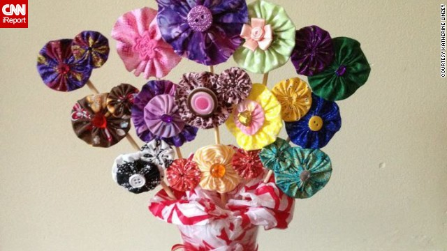A fabric-flower hair clip display made as a raffle gift for a fundraiser for <a href='http://www.anabelleswish.org' target='_blank'>Anabelle's Wish</a>, a charitable organization in Anabelle's name to assist families who have children with rare neurological disorders.