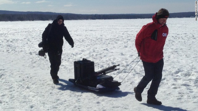 CNN correspondent Ted Rowlands, right, and Jake Carpenter walk almost four miles round-trip to the ice caves, pulling all of their equipment.