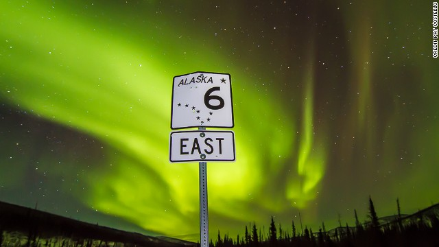 About 65 miles north of Fairbanks at 3:30 a.m. and -11 degrees F (-24 C), a dazzling aurora inspired an audience of one to turn a Steese Highway sign into art.