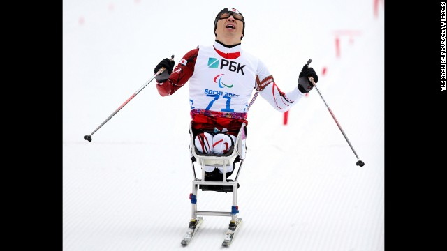 Kozo Kubo of Japan crosses the finish line in the men's biathlon on March 14.
