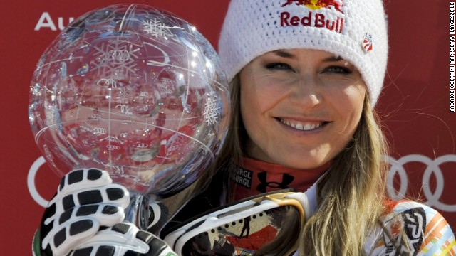 American skier Lindsey Vonn poses with her Crystal Globe after claiming the overall title in March 2012.