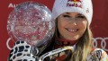 American skier Lindsey Vonn poses with a crystal globe after claiming the title of overall World Cup winner at the Alpine ski World Cup finals in March 2012.