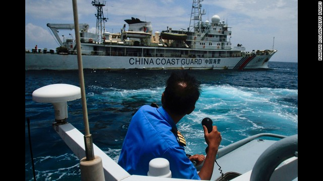 A member of the Malaysian navy makes a call as his ship approaches a Chinese coast guard ship in the South China Sea on March 15.