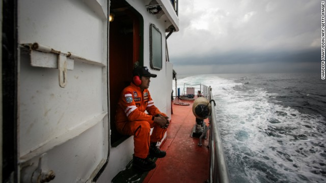 Indonesian personnel watch over high seas during a search operation in the Andaman Sea on Saturday, March 15.