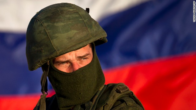 A pro-Russian soldier, with the Russian flag behind him, mans a machine gun outside an Ukrainian military base in Perevalne on March 15.