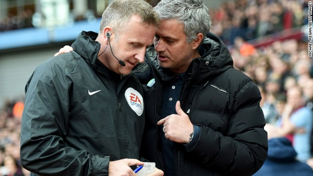Mourinho talks to fourth official Jonathan Moss prior to the match at Villa Park.