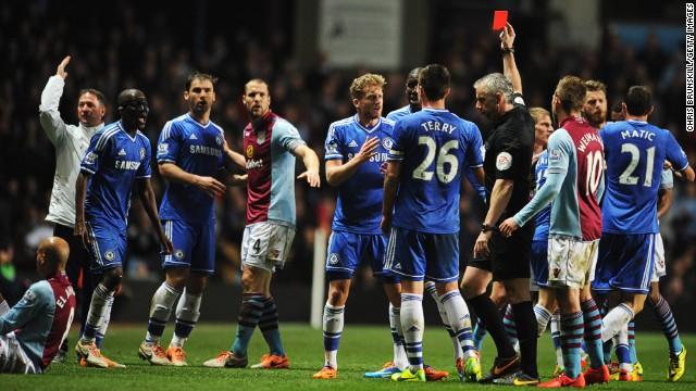 Chelsea midfielder Ramires was sent off for a nasty tackle on Aston Villa's Karim El Ahmadi, sparking angry scenes at the English Premier League match.
