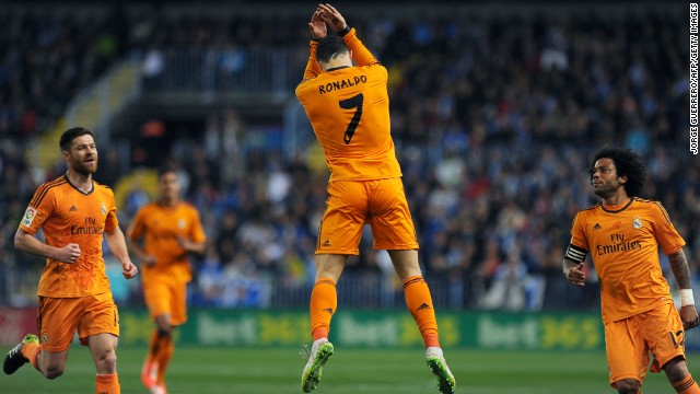 Cristiano Ronaldo leaps in celebration after scoring the only goal in Real Madrid's win at Malaga's Rosaleda stadium.