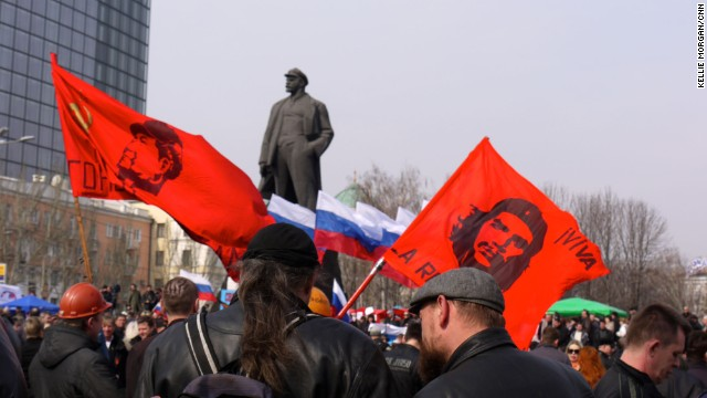 DONETSK, UKRAINE: Demonstrators wave revolutionary flags at a major pro-Russia rally in Lenin Square in central Donetsk (March 15). Some are calling for independence from Ukraine. Others are calling for union with Russia. Photo by CNN's Kellie Morgan.