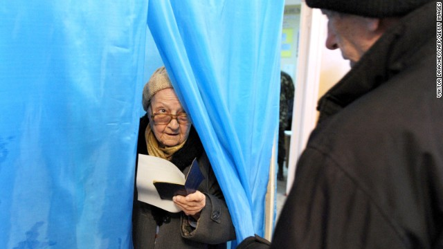 A woman leaves a voting booth in Sevastopol on March 16. See the crisis in Ukraine before Crimea voted
