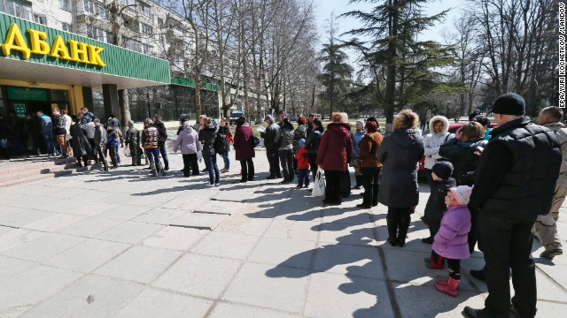 People stand in line to vote at a bank office in Simferopol, Ukraine. Results are expected on Monday. The United States has already said it expects the Black Sea peninsula's majority ethnic Russian population to vote in favor of joining Russia.