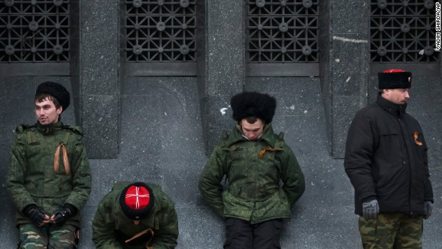 Cossacks guard the regional parliament building during the Crimean referendum in Simferopol.