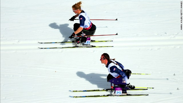Beth Requist and Tatyana McFadden of the United States compete in the women's cross-country 5-kilometer sitting event.