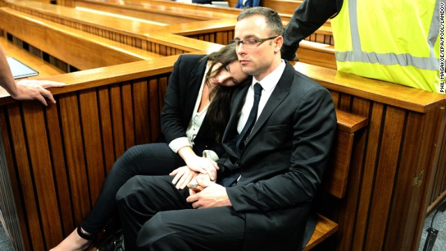 Oscar Pistorius sits with his sister Aimee Pistorius during his murder trial at the high court in Pretoria, South Africa, on Friday, March 14. Pistorius, the first amputee to compete in the Olympics, is accused of murdering his girlfriend, Reeva Steenkamp, on February 14, 2013.