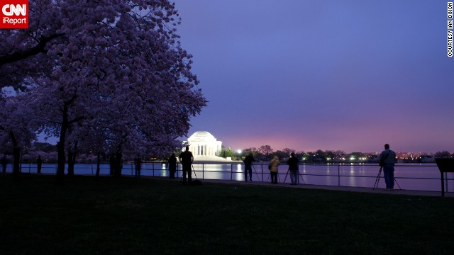 "Travelers enjoy the sight of cherry blossoms so much that crowds start gathering in the park as early as sunrise, which is when <a href='http://ireport.cnn.com/docs/DOC-763864'>Ian Dixon</a> captured this photograph in March 2012. ""Even at 7 a.m. it was getting tough to find good spots to shoot from due to all the photographers around,"" he said."
