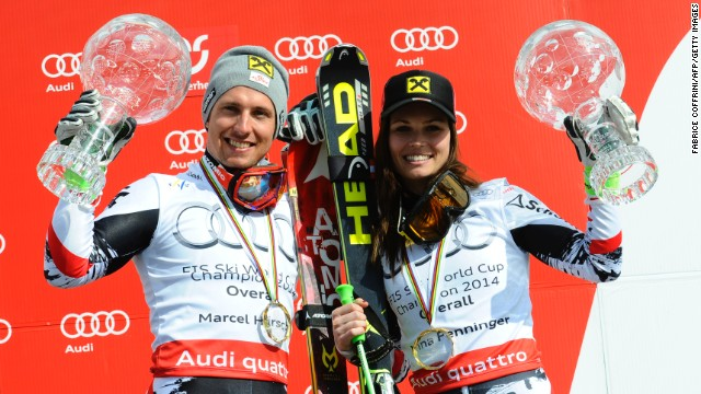 Austrian skiers Marcel Hirscher (left) and Austria's Anna Fenninger celebrate with their trophies after winning the men's and women's 2014 World Cup titles.