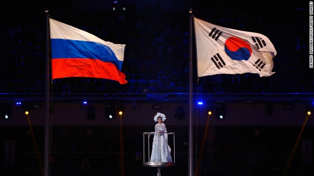 The Russian and South Korean flags fly as a performer sings. South Korea will host the 2018 Paralympic Winter Games.