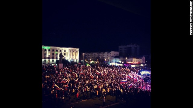 "SIMFEROPOL, UKRAINE: ""Celebrations already well underway here in Lenin Square in Simferopol (March 16)."" - CNN's Dominique Van Heerden. Follow Dominique on Instagram at instagram.com/dominique_vh."