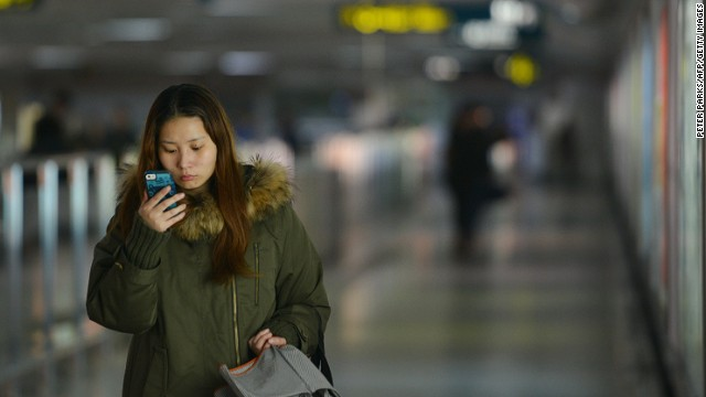 A woman uses her smartphone in a Shanghai metro station. Chinese mobile platforms are growing in popularity.