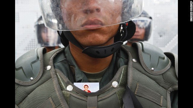 A National Guard member stands during an anti-government march in Caracas on March 16.