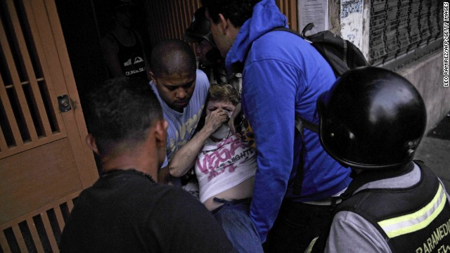 An injured demonstrator receives help during clashes in Caracas on March 15.