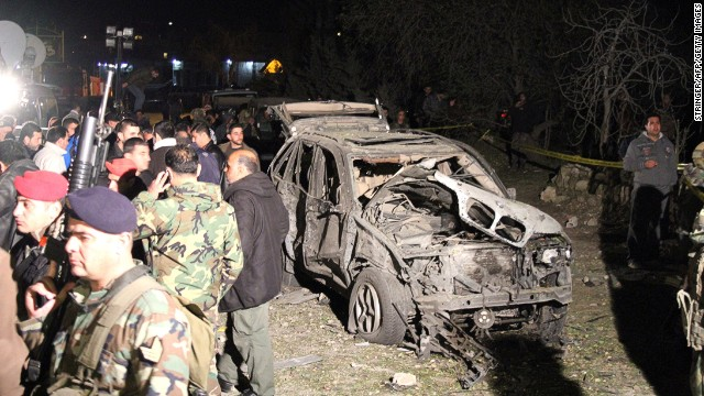 Lebanese security forces inspect the site of a suicide car bomb attack near Nabi Uthman on March 16, 2014.